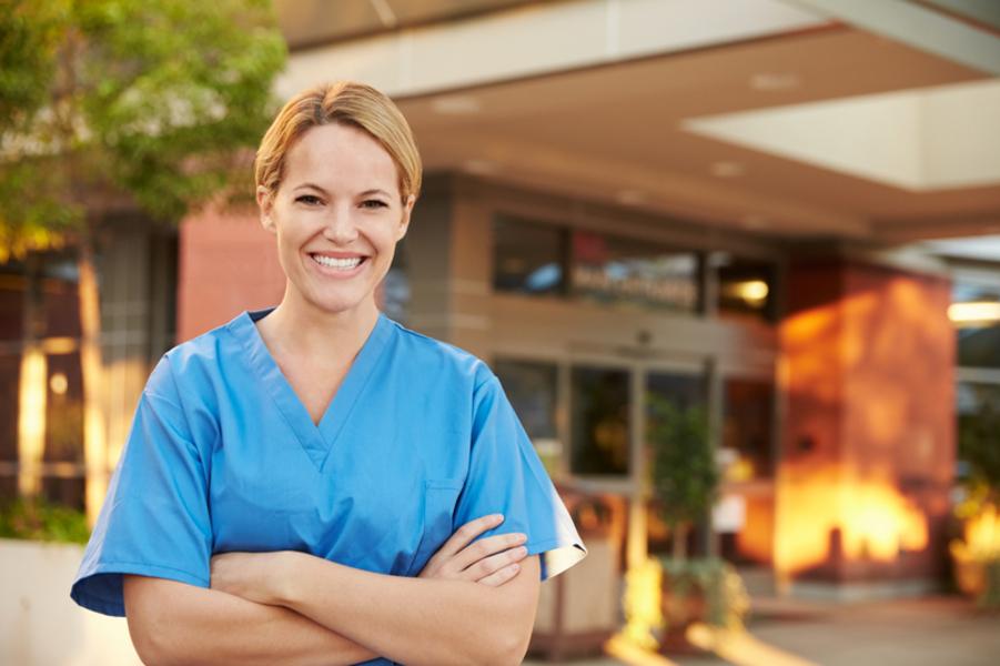 Portrait Of Female Doctor Standing Outside Hospital